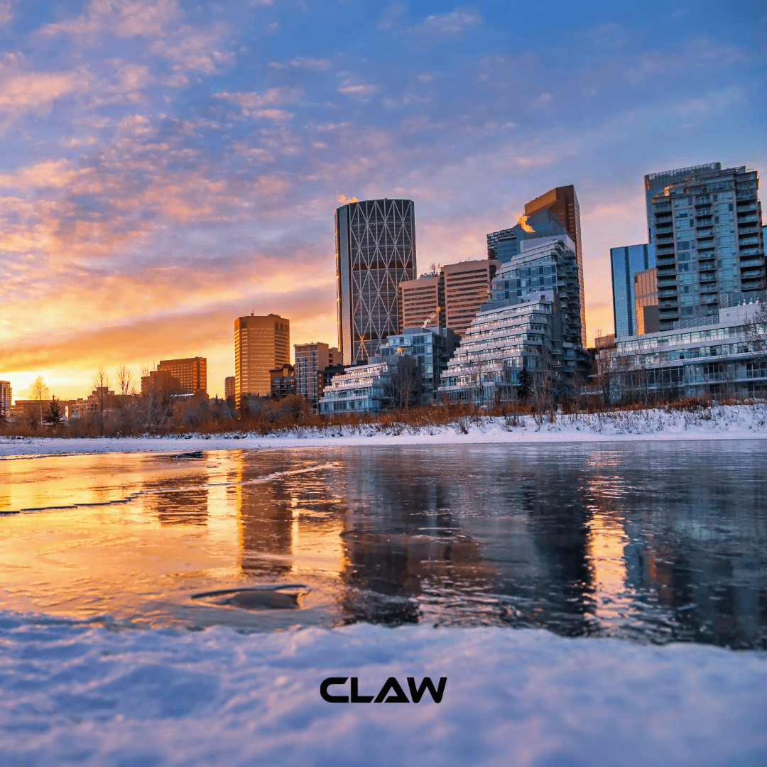 Calgary skyline at sunset where Claw Roofing is located
