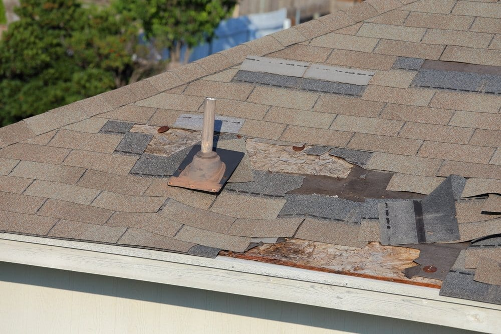 Calgary Roofing Company - Claw Roofing - A close up view of shingles and roof damage