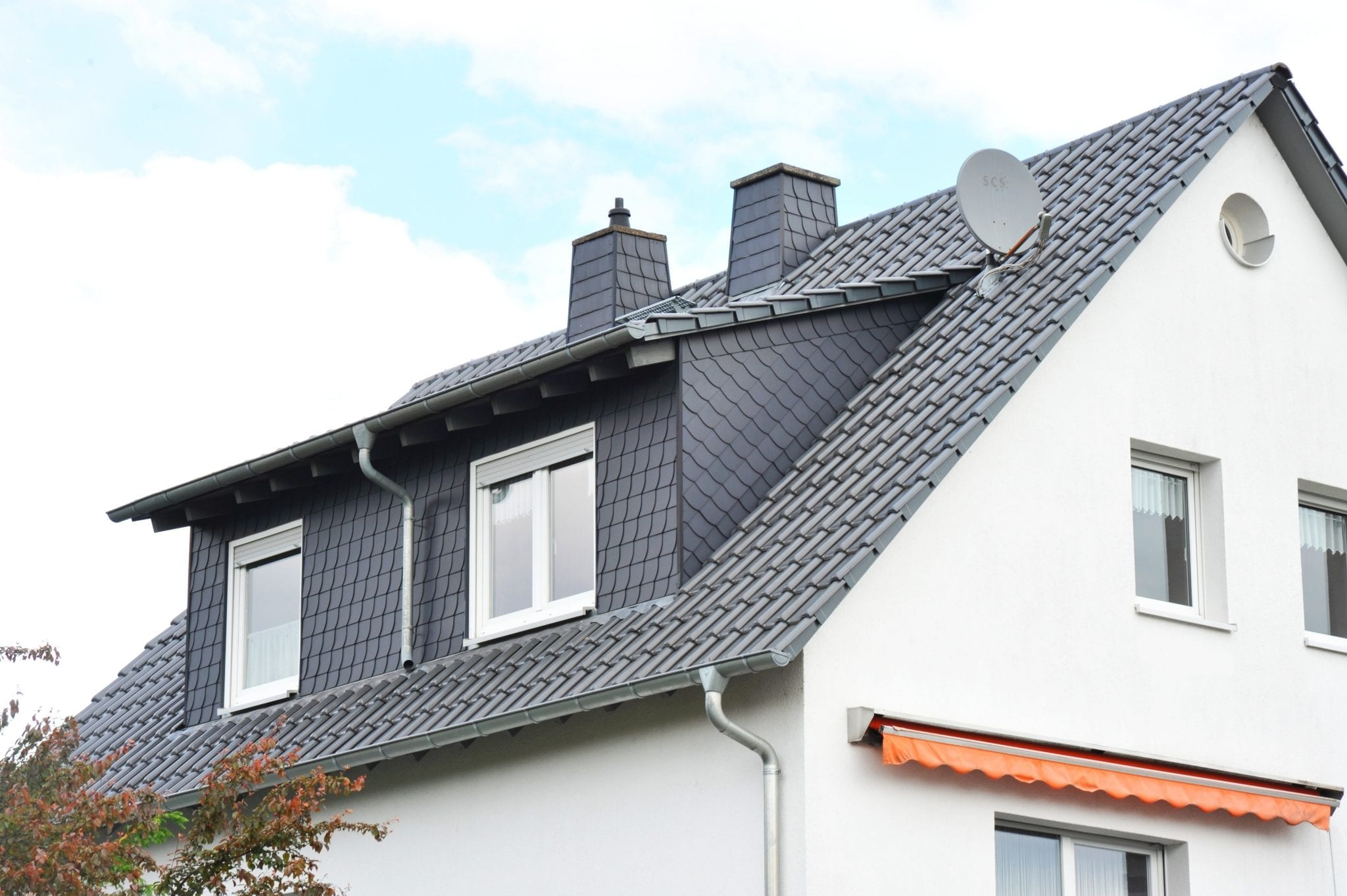 Calgary Roofing Companies | Claw Roofing | Dormers Added To Home