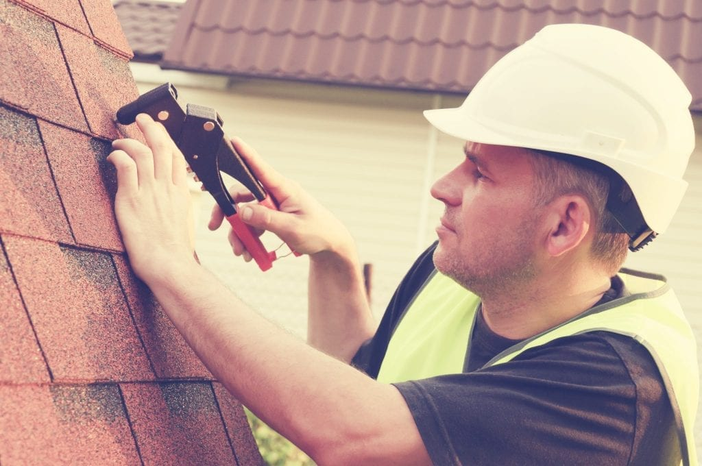 journeyman replacing a calgary roof calgary roofing company claw roofing