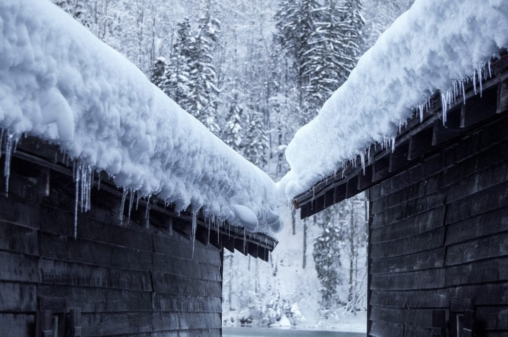 residential-roofing-calgary-gutter-damage-winter-icedams-Claw-Roofing.